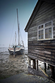 Sailing barge and shed, freezing fog, West Mersea