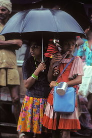 Indian schoolgirls in monsoon rain