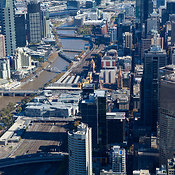 View down Flinders street.  With Flinders Street station and Federation Square visible.