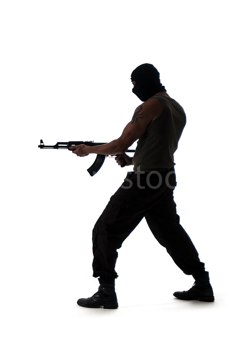 figurestock a silhouette of a man in a mask standing and pointing