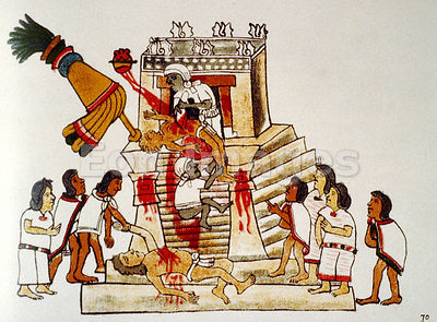 Aztec priest performing human sacrifice