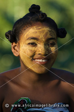 Girl with traditionally painted face from the Sakalava tribe, Nosy Be