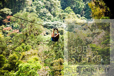 Toursit using zip lines at the Sky Trek, Arenal Volcano area, Costa Rica