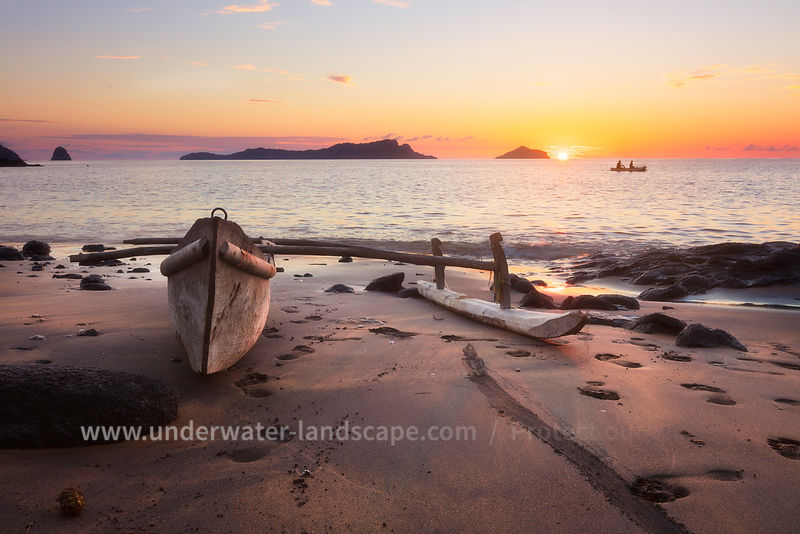 sunset a pirogue on a beach of Mohéli island -Comoros