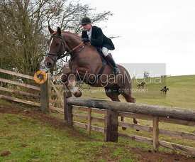 Nick Wright - Cottesmore Hunt followers jump a hunt jump near Somerby