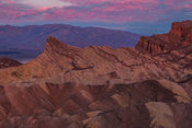 Zabriskie Point at dawn with pink hues, Death Valley National Park, California, USA
