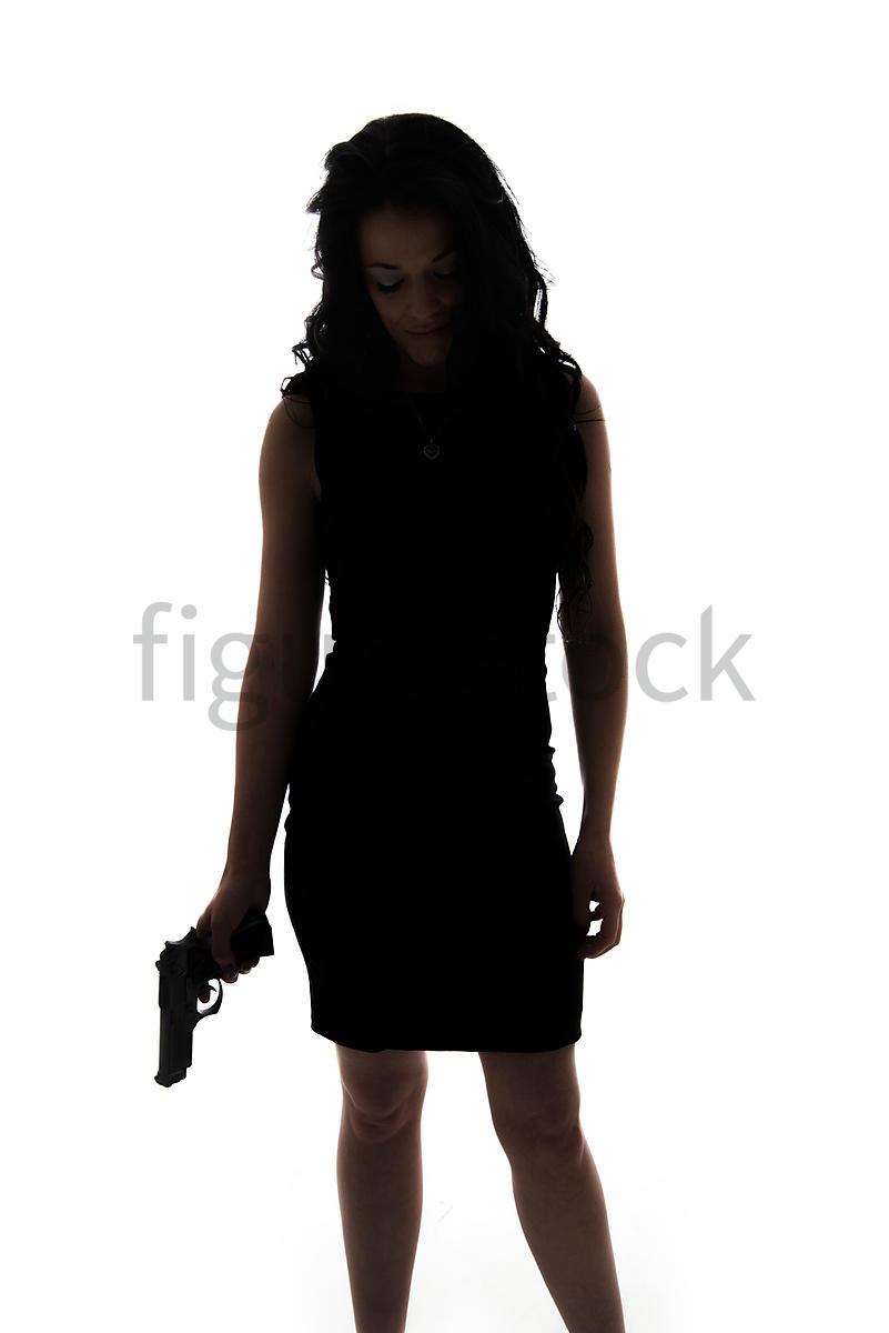 figurestock a figurestock image of a woman holding a gun in
