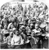 Poor Chinese receive food aid, ca. 1902