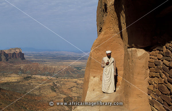 Photos And Pictures Of Priest Standing On The Cliff Edged