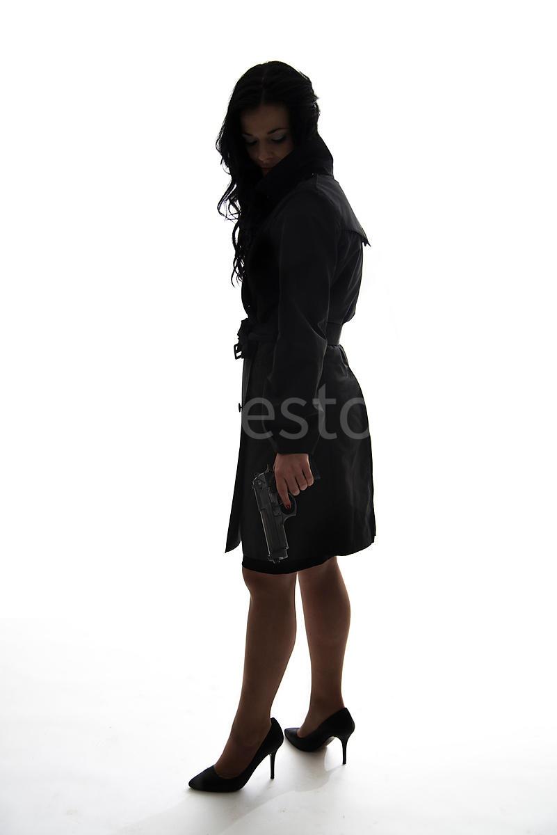 figurestock a silhouette of a woman standing with a gun shot