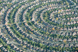 Aerial view over rows over houses in the suburbs