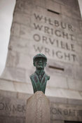 Wright Brothers Monument and Orville Wright bust in Wright Brothers National Memorial, Kill Devil Hills, North Carolina, USA