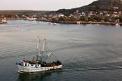 Fishing boat returns to port at sunset, Mazatlán, Sinaloa, Mexico