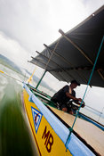 View from blue wooden pump boat with driver on Lake Taal, Talisay, Batangas, Philippines