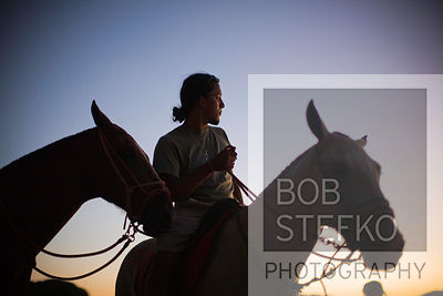 Dusk over Barcelo Langosta Beach with man and horses, Tamarindo, Costa Rica
