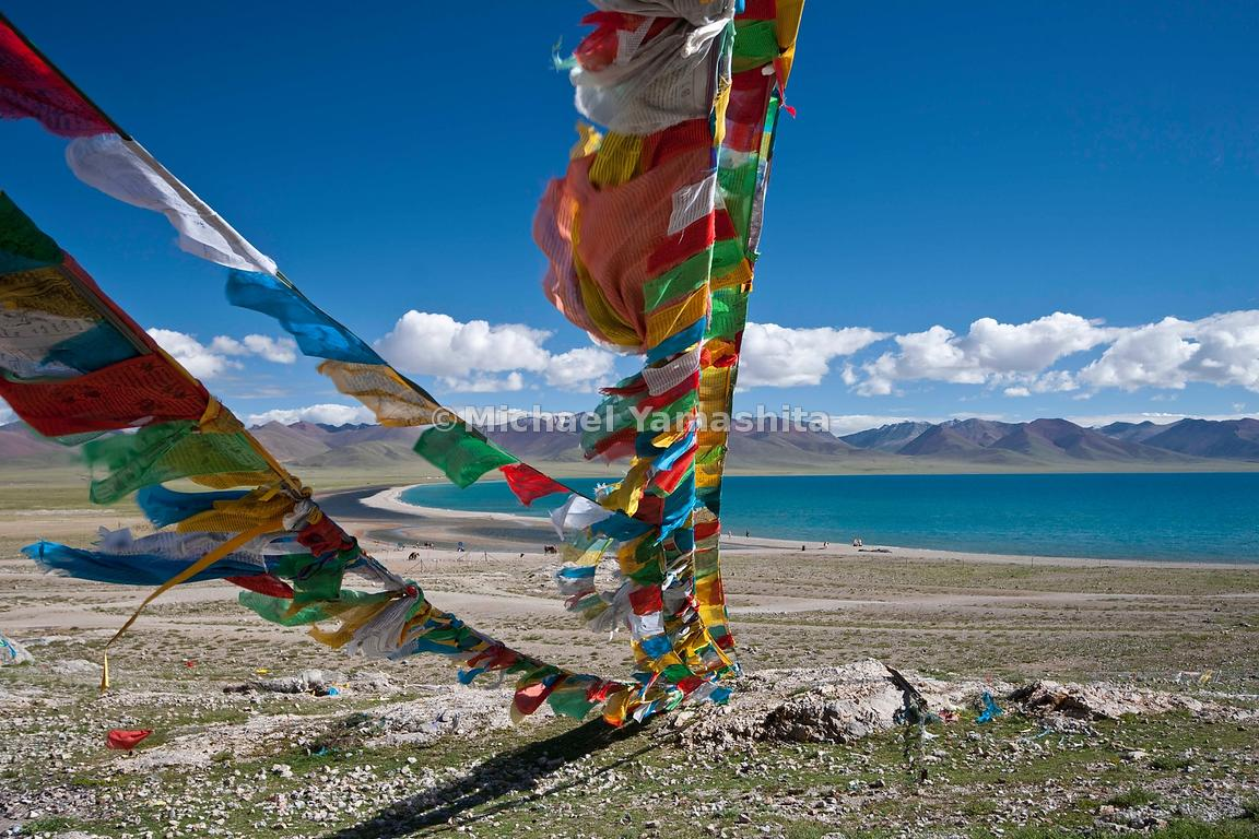 Prayer Flags Inscribed With Buddhist Sutra Prayers Frame Namtso Lake In Primary Colors