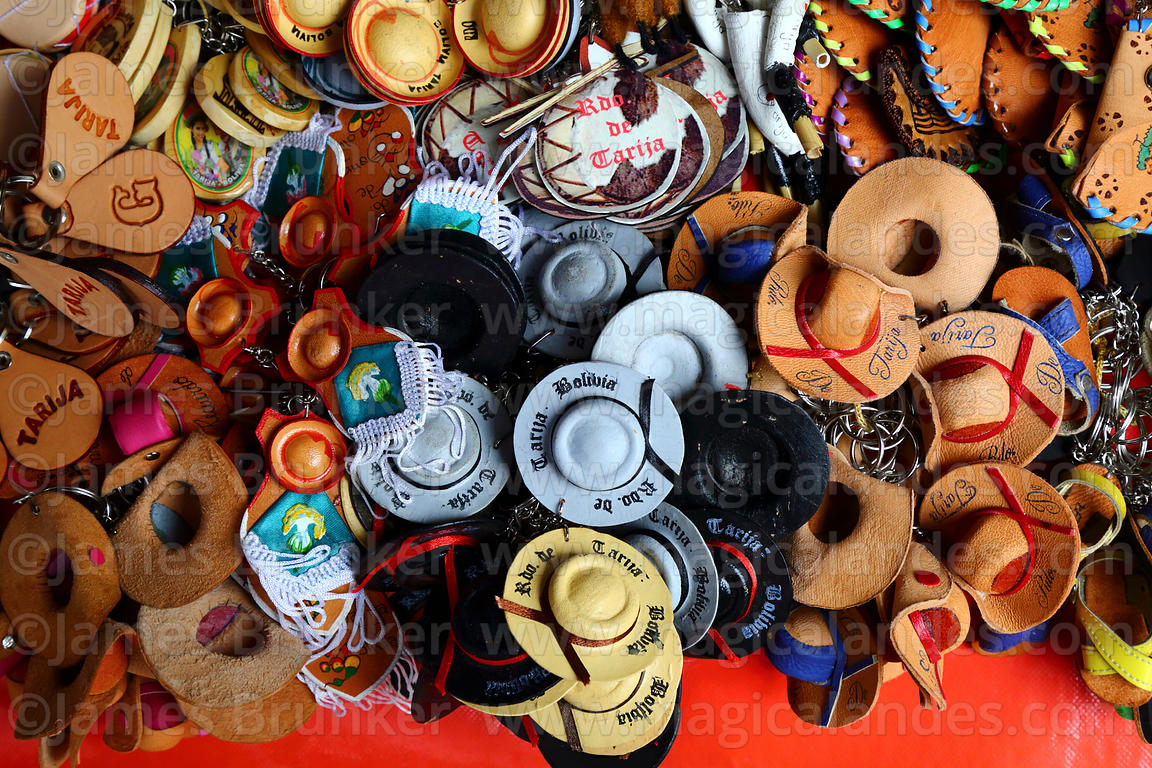 Keyrings with miniature regional leather hats for sale in souvenir shop 959486d49523