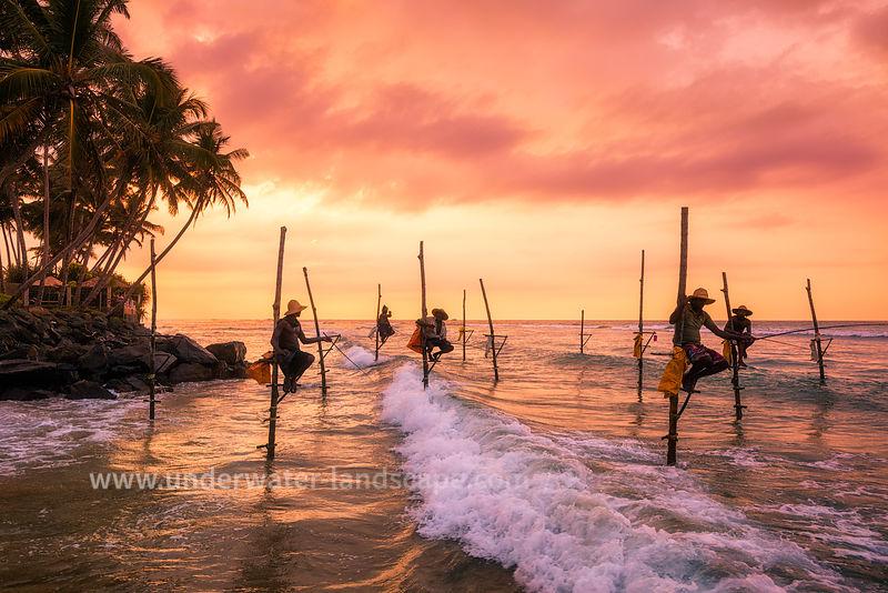pictures of Fisherman on their canes - Nilaveli Beach Sri Lanka