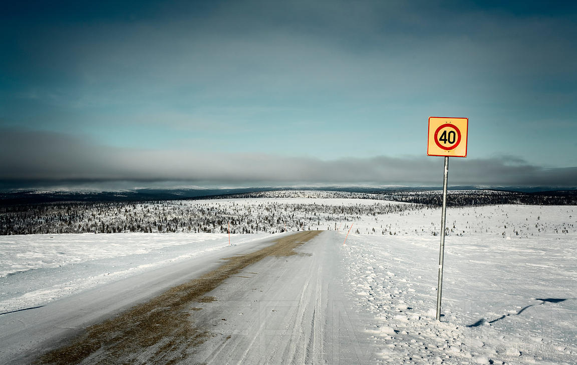 Image Speed Limit Roadsign On Icy Road Stock Photo By