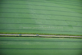 Aerial view of road cutting through fields