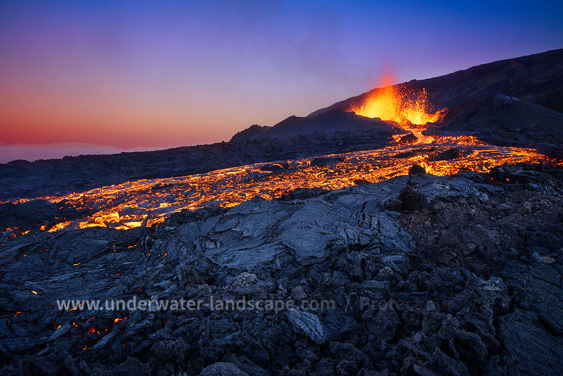 sunset picture on the piton de la fournaise in eruption - reunion island - Magma and blue hour