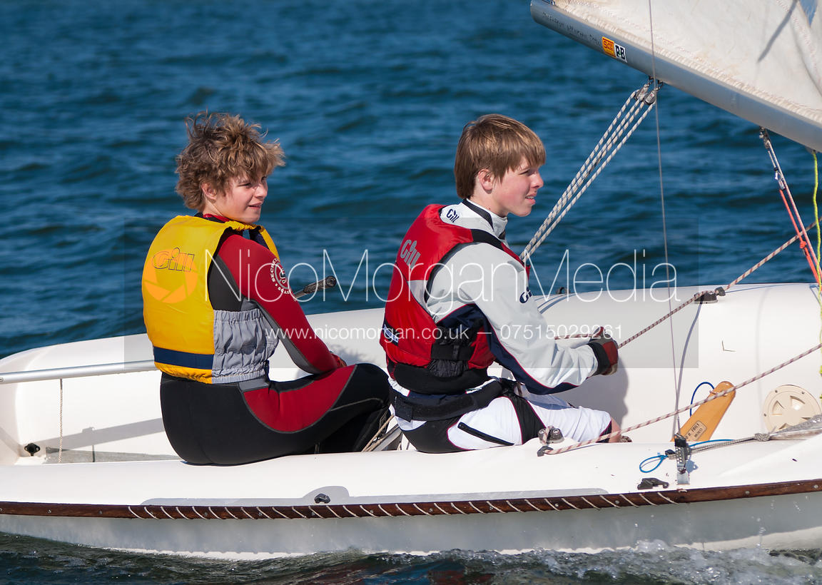 Teenagers sailing 420 dinghies