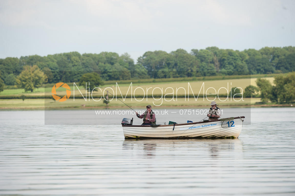 Image two fishemen fly fishing from a boat on rutland for Fly fishing boats