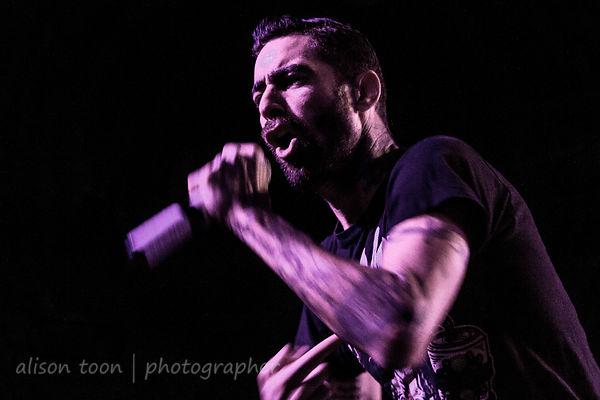 Adrian Estrella, vocals, Assuming We Survive