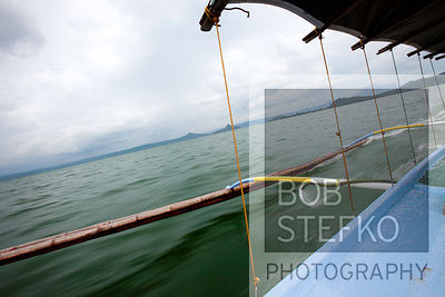 View from blue wooden pump boat on Lake Taal, Talisay, Batangas, Philippines
