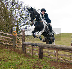 Hilary Butler jumps a hunt jump near Somerby