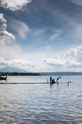 Local residents dive and swimming in Lake Taal, Talisay, Batangas, Philippines