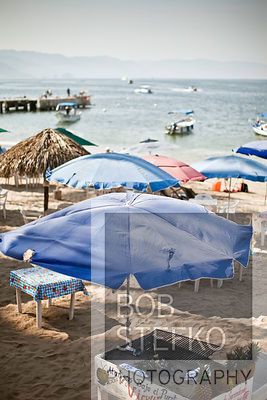 Beach with umbrellas and small boats,Puerto Vallarta, Jalisco, Mexico