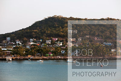 Colorful houses grouped together on hill tops near coast, Mazatlán, Sinaloa, Mexico
