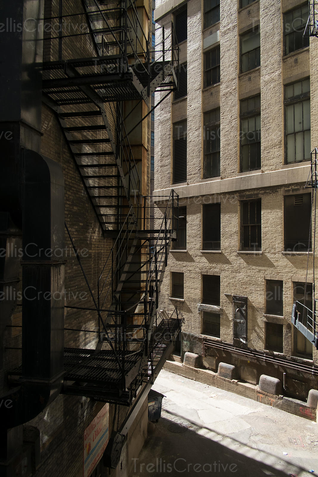 Alley View Of Iron Fire Escape Staircases On The Exterior Of A Building At  Chicago,