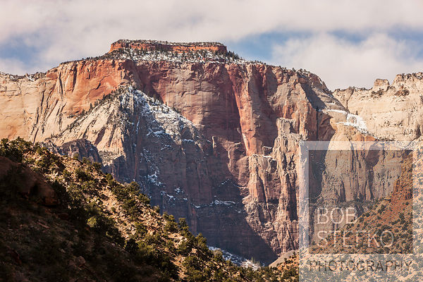 Rock formations in orange tones with dusting of snow, Zion National Park, Utah, USA