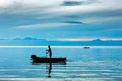 Two fishing boats at dawn on Lake Taal, Talisay, Batangas, Philippines