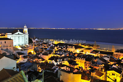 Alfama at dusk, seen from the Portas do Sol belvedere. Lisbon, Portugal