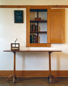 Table and built-in cupboard