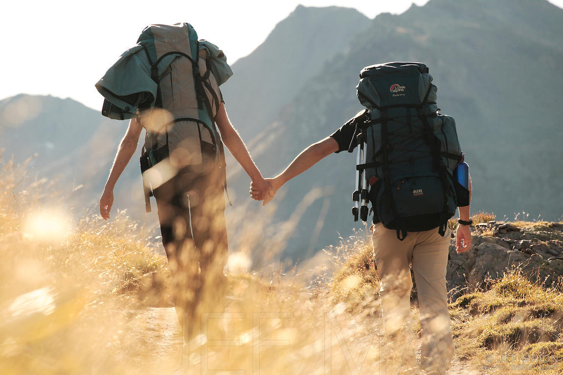 Image Backpackers Couple Walking Hand In Hand Stock