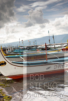 Pump boats on shore line of Taal Volcano Island, Lake Taal, Talisay, Batangas, Philippines