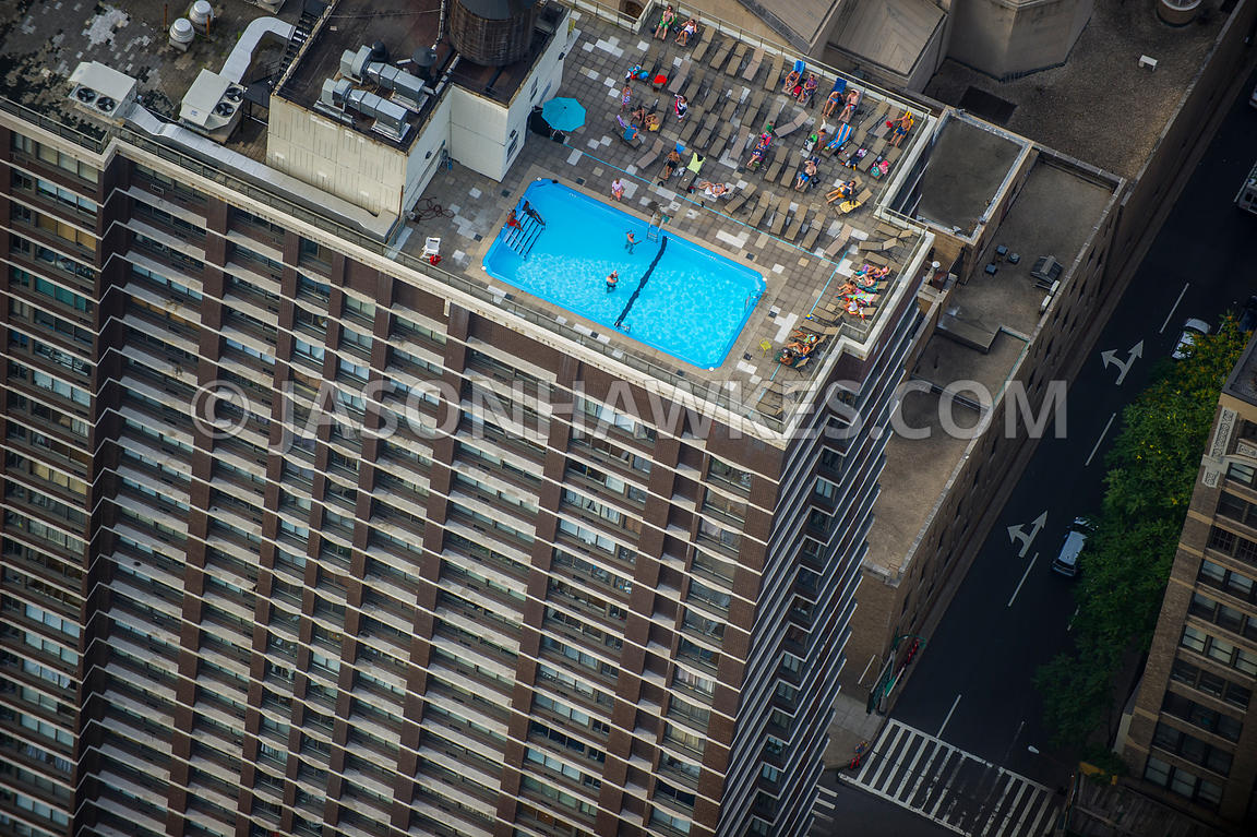 Pool On Top Of Building : Aerial view people in a swimming pool on top of