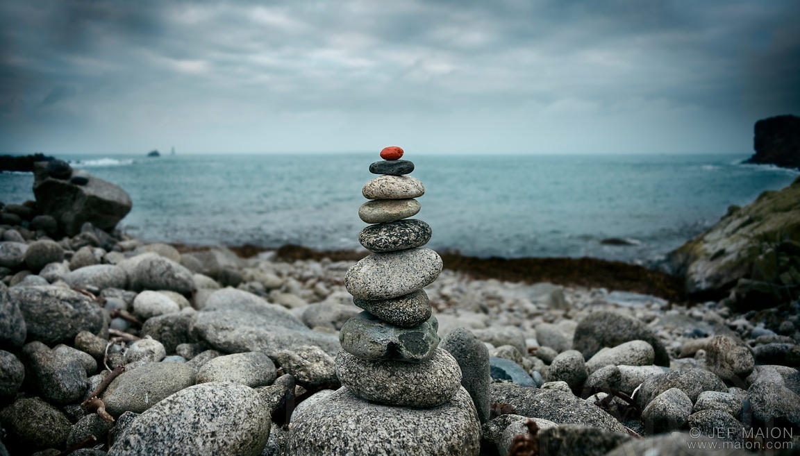 image cairn rock pile on peeble beach stock photo by jf maion