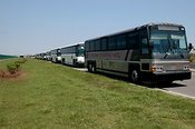 Charter buses wait to carry Katrina survivors to shelters