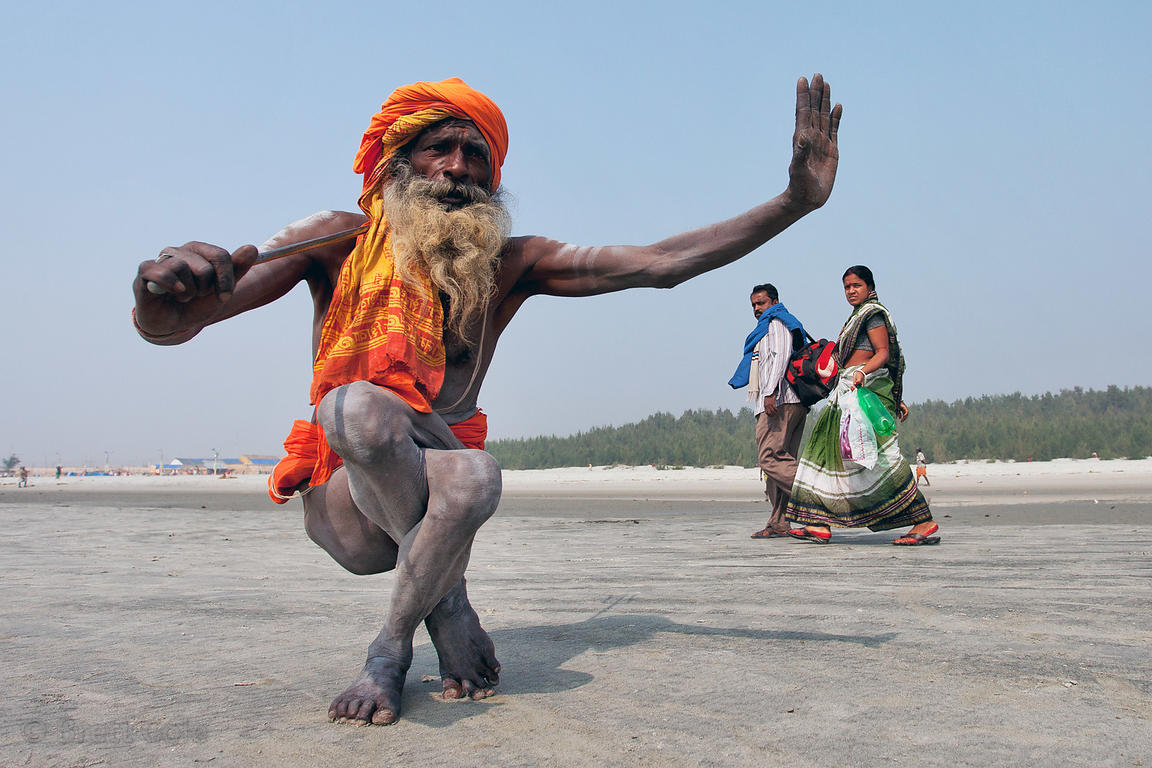 An Elerly Sadhu Holy Man Does Yoga At The Gangasagar Mela A Hindu