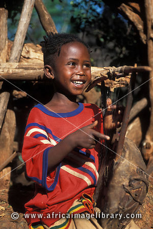 Photos and pictures of: Konso girl playing a traditional ... | 300 x 450 jpeg 96kB