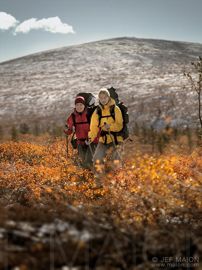 Image Two Women Hiking In Autumn Landscape Stock Photo