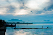 View at dawn of Lake Taal with pump boats and dock, Talisay, Batangas, Philippines