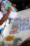 Street scene in Kaibigan neighborhood with group gambling, San Andres Bukid, Manila, Philippines