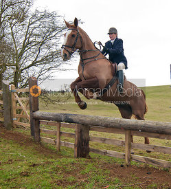 Monica Tebbutt-Wheat jumps a hunt jump near Somerby