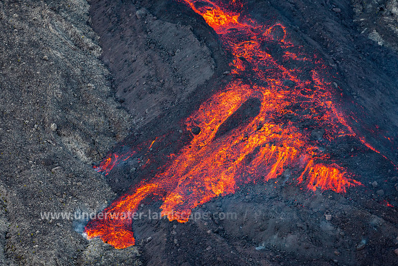 aerian picture of the volcano piton de la fournaise in eruption - gabriel barathieu